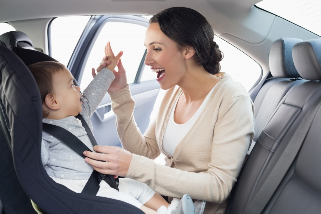 baby attached in car seat