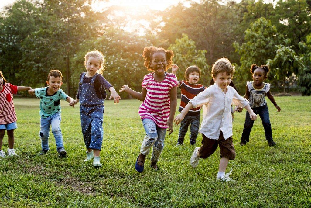 Children running at the park